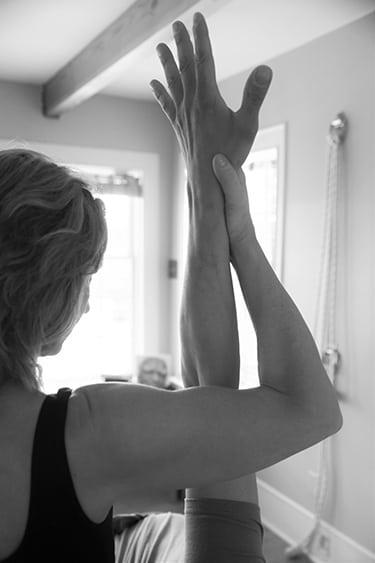 Leigh - Assisting a Yoga Pose